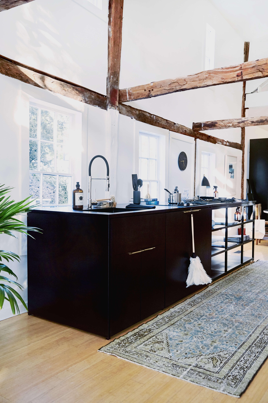 custom kitchen island of ebonized oak with lab counter at the line amagansett | 12