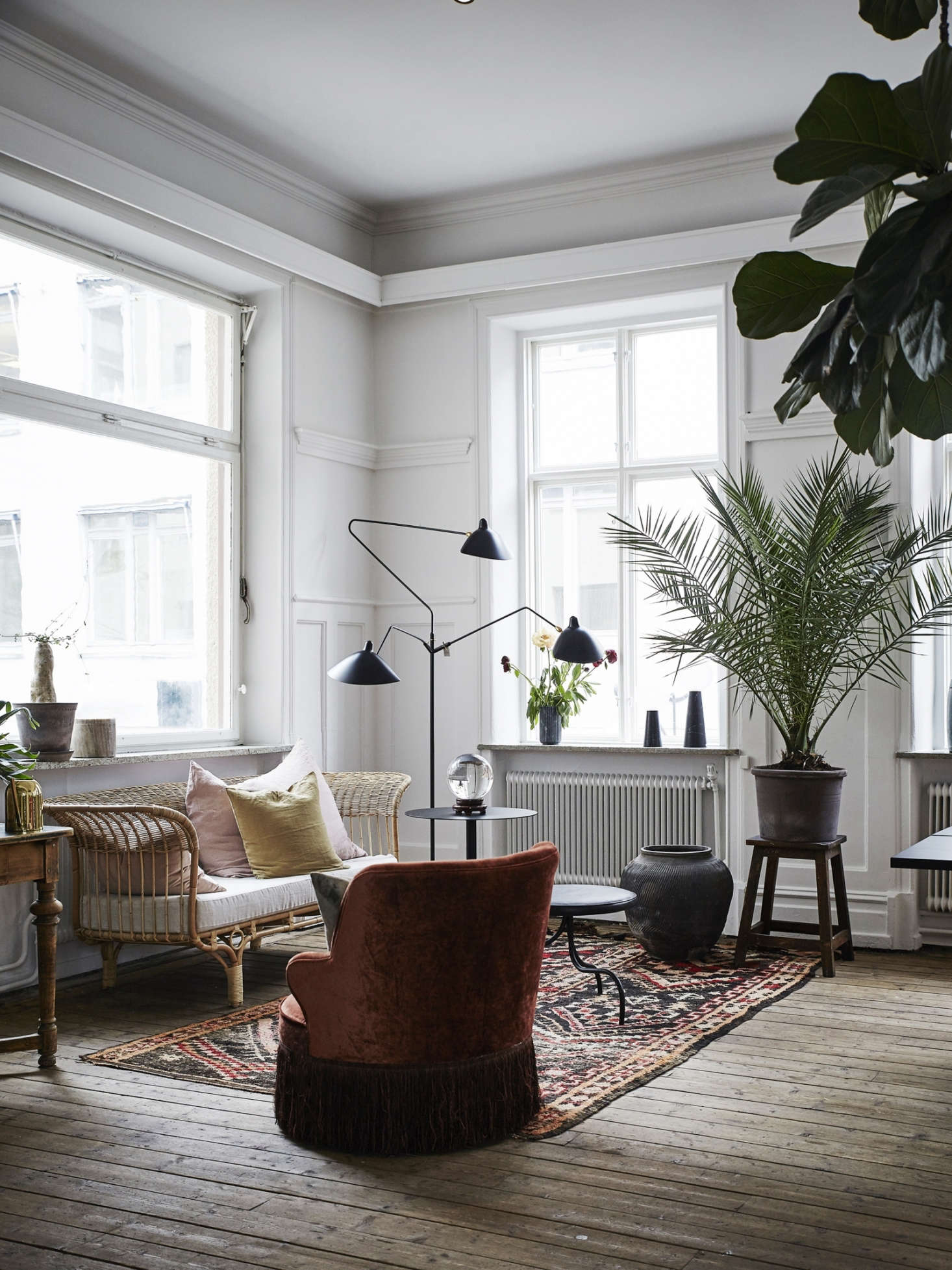 An intimate grouping of furniture, plants, and lighting at the Artilleriet apartment in Sweden has a dynamic circular flow. Photograph by Johanna Bradford,courtesy ofArtilleriet.
