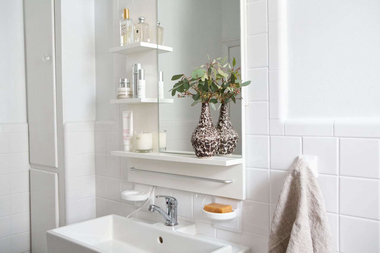 Athena replaced the original sink with a Lillangen Talleviken Sink Cabinet with two doors ($9 from Ikea); the chrome-plated Olskär Bath Faucet from Ikea is $.99.