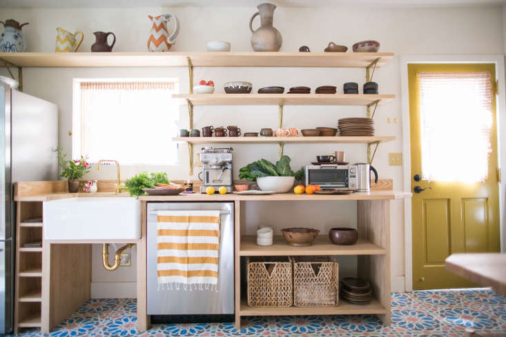 A small kitchen with a custom counter of cubbies for fixtures, appliances, and cookware from Kitchen of the Week: An Echo Park Kitchen Revived, Budget Edition.