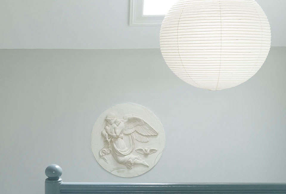 two grey rooms on the wall and blue smoke on the railing; \$48.67 per liter at  11