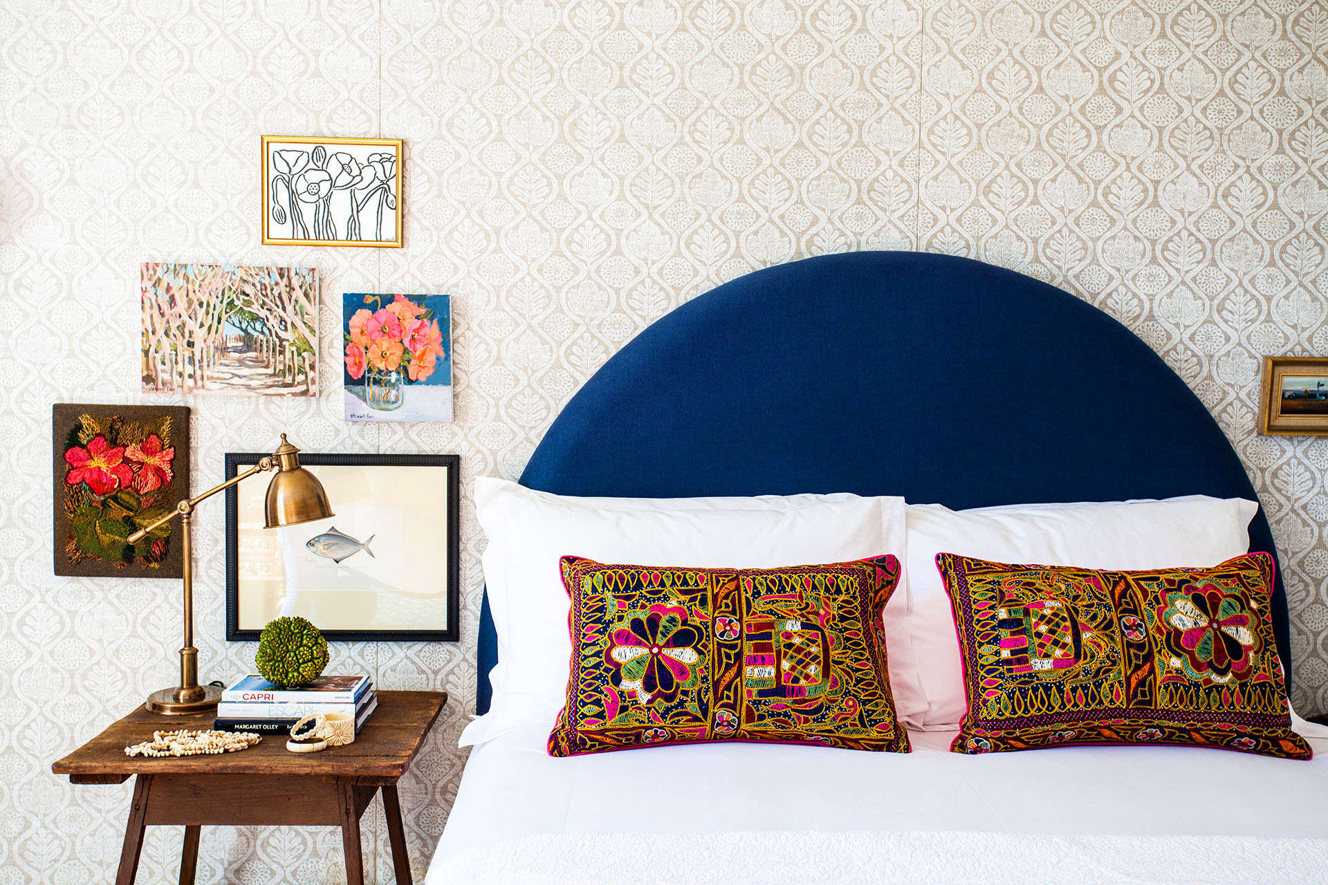 A bright mix of fabric patterns on headboard and walls at Halcyon House, a boutique hotel in Cabarita Beach, Australia, designed by Anna Spiro| Remodelista
