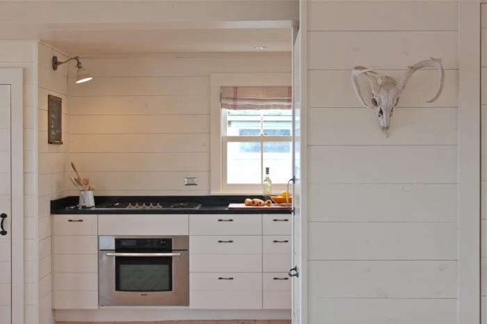 At Harbor Cottage architect/designer Sheila Bonnell employed traditional shiplap in a clean, modern way to create a contemporary space that is still very much in context with the rural Maine setting. Photograph by Justine Hand.