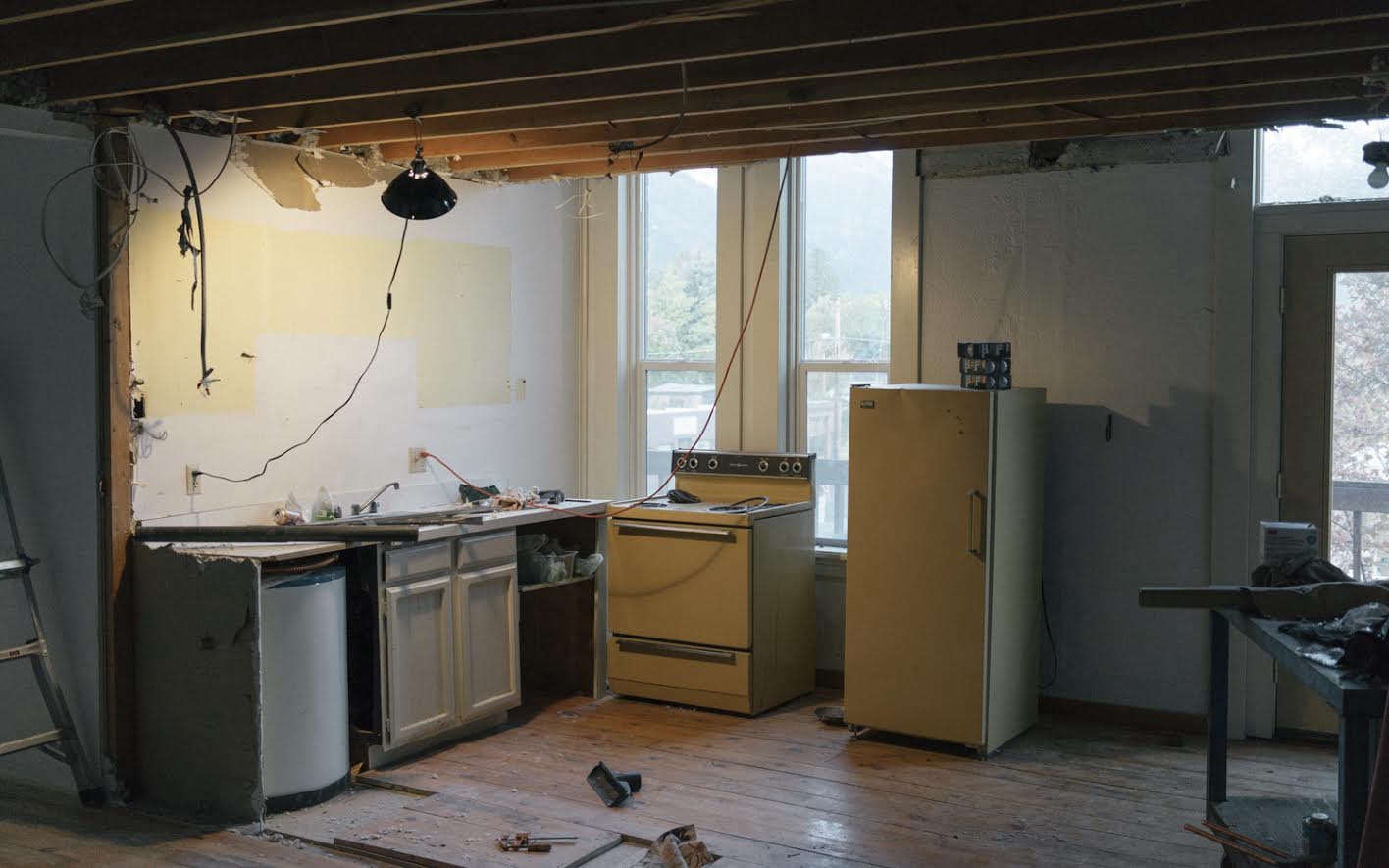 They demolished the kitchen; it had been poorly constructed and only the plumbing was usable.