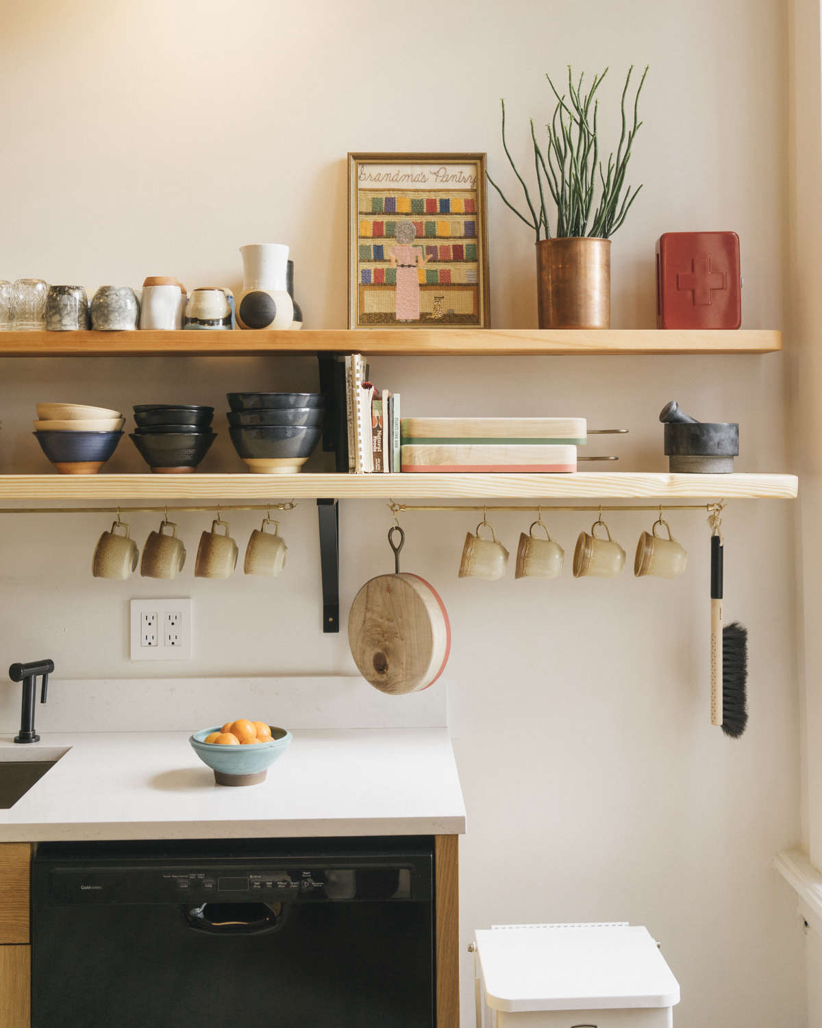 The plates, bowls, and cups are a mix of garage-sale finds and work by Portland ceramicist Addy Kessler. The open shelves are made of fir planks with off-the-shelf brackets.