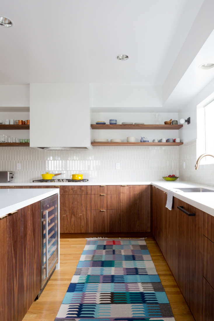 Shelves run across the short leg of this L-shaped kitchen, providing open storage for kitchenware fromKitchen of the Week: A Six-Week Transformation in Los Feliz.