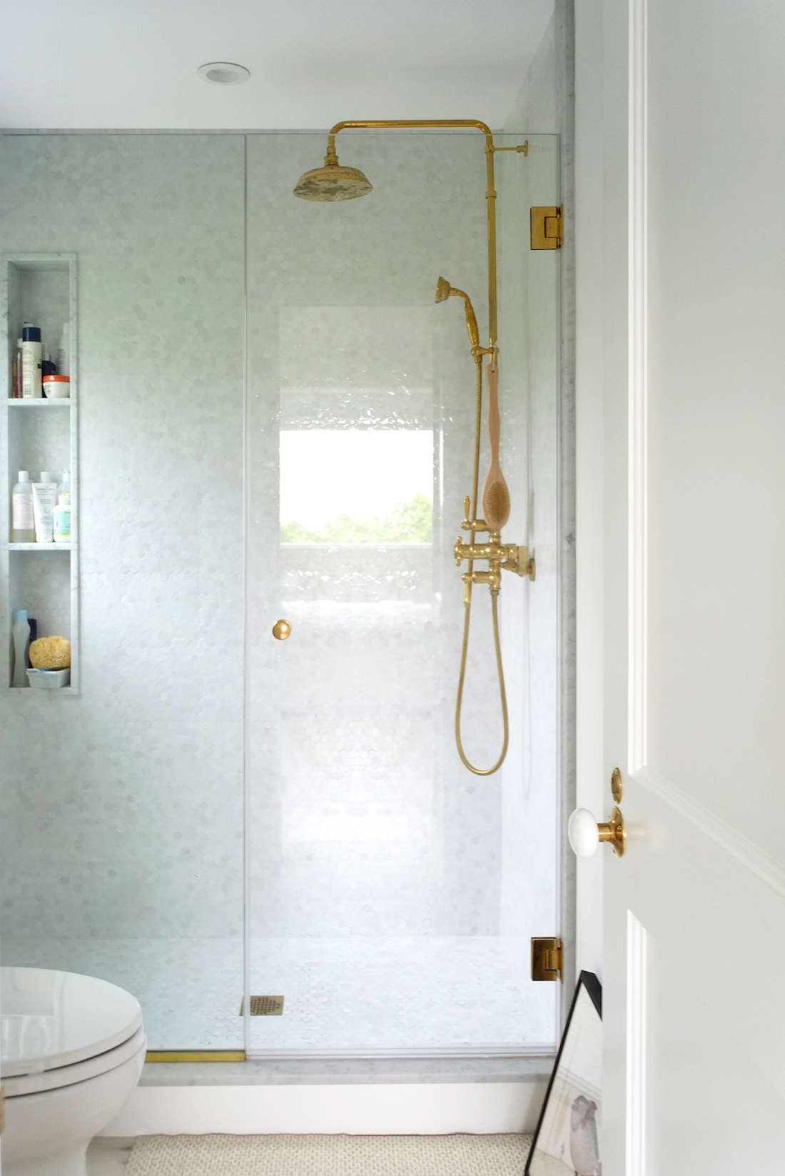 The master bath sports shower tiles from Mosaic House.