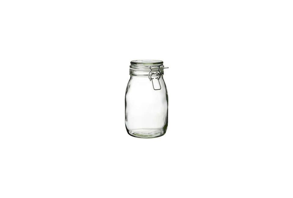 Steal This Look Smart Storage in a Swedish Kitchen Ikea&#8\2\17;s Korken Clear Glass Jar with Lid, used in this kitchen as a flower vase, is \$3.99.