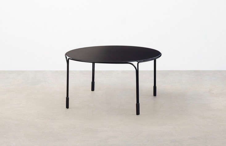 round metal black outdoor coffee table gardenista e1467940278896 11