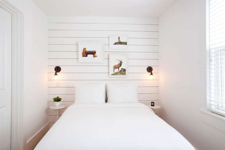 A shiplap-paneled accent wall at Salt House Inn in Provincetown, situated in a historic cedar-shingled building—see The Hamptons Come to Cape Cod.