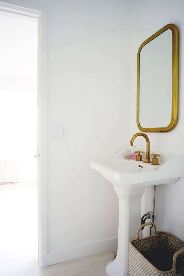 The brass fixtures in the master bathroom are from Rohl.