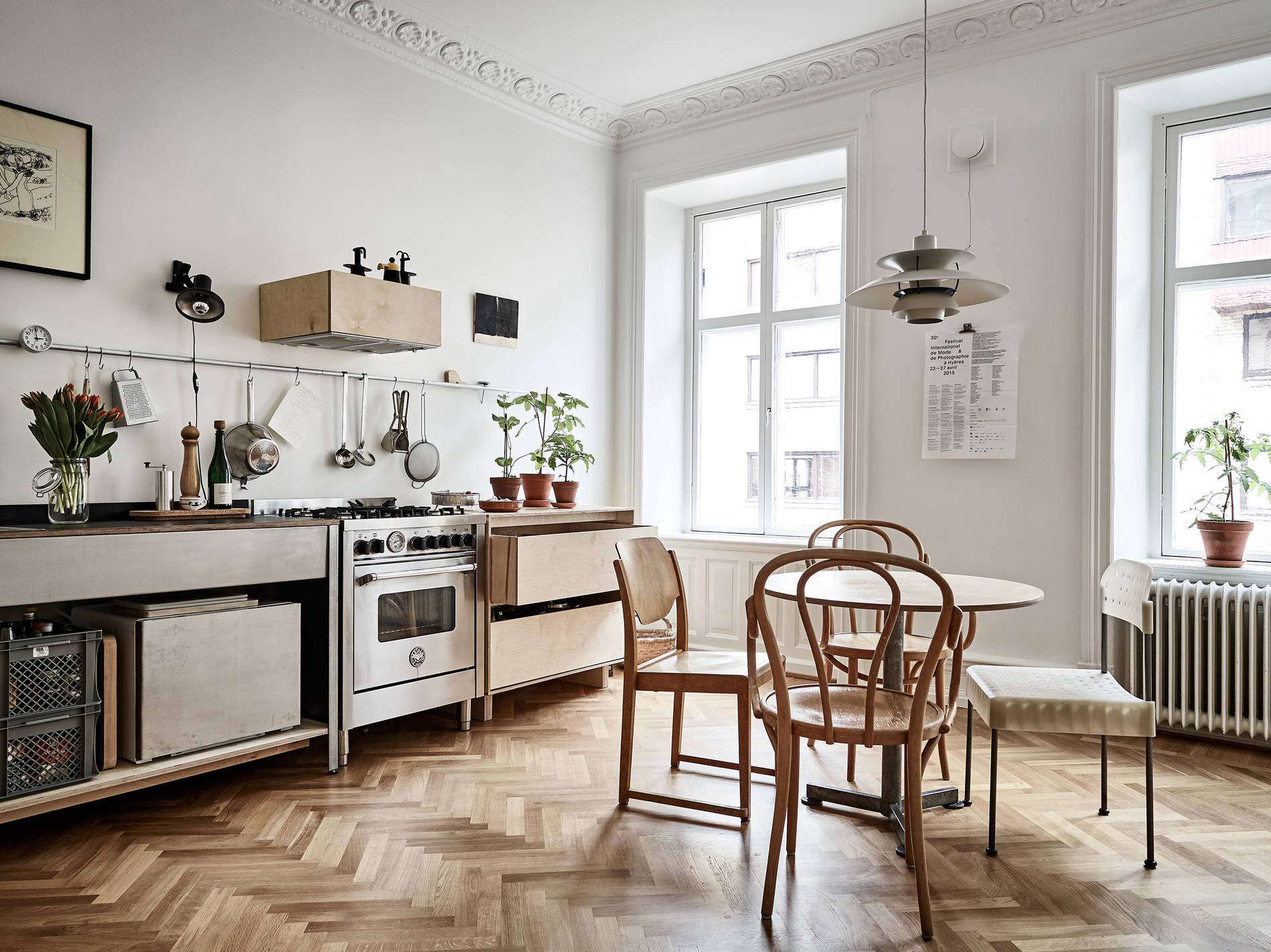 Steal This Look Smart Storage in a Swedish Kitchen A smallrounddining table is paired with a mixofvintage chairs. Photograph courtesy of Stadshem.