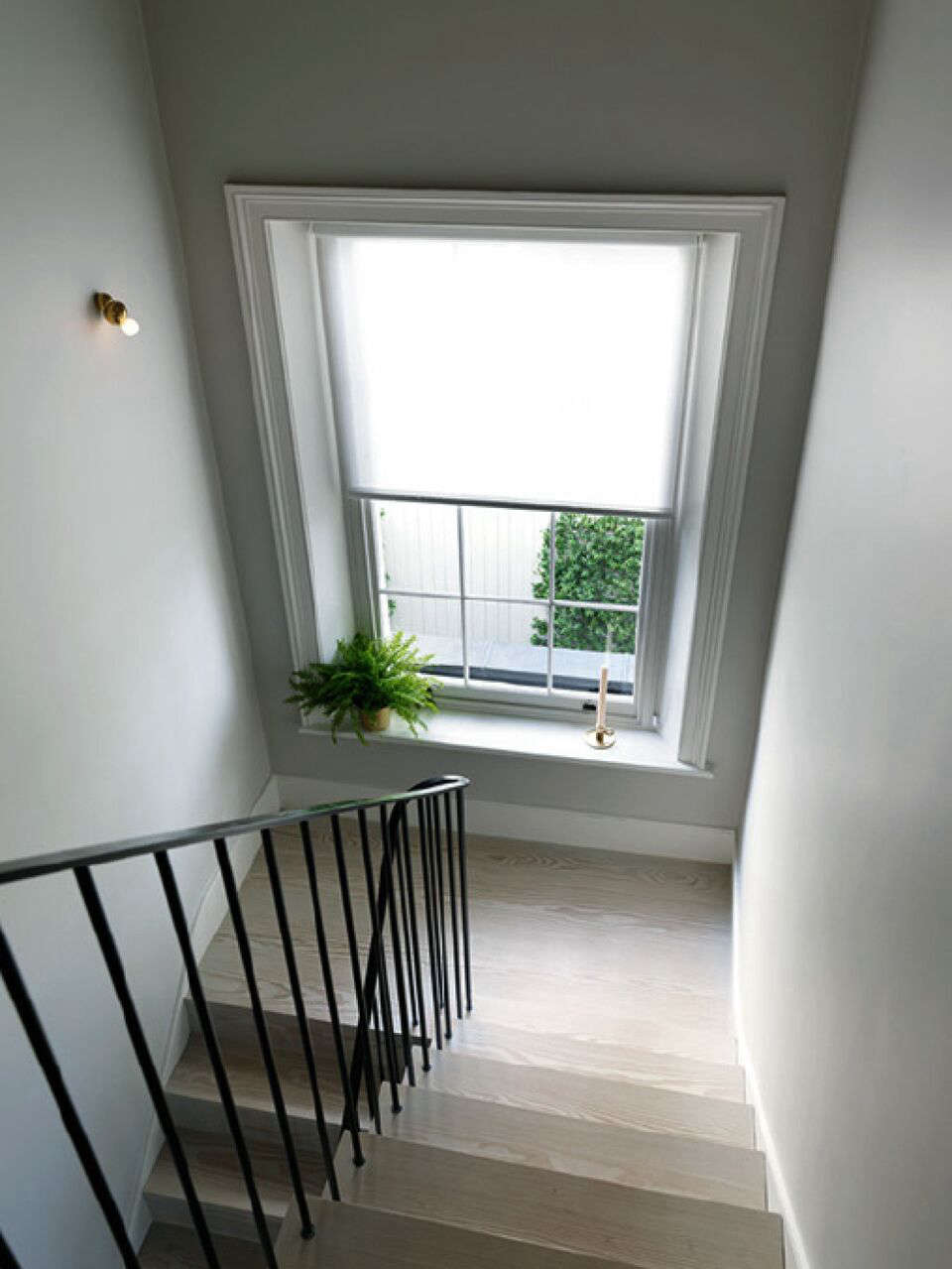 A Notting Hill Townhouse Tailored for Living by Charles Mellersh Villem Hammershoi inspired stairwell in a remodeled Notting Hill townhouse with interior design by Charles Mellersh   Remodelista