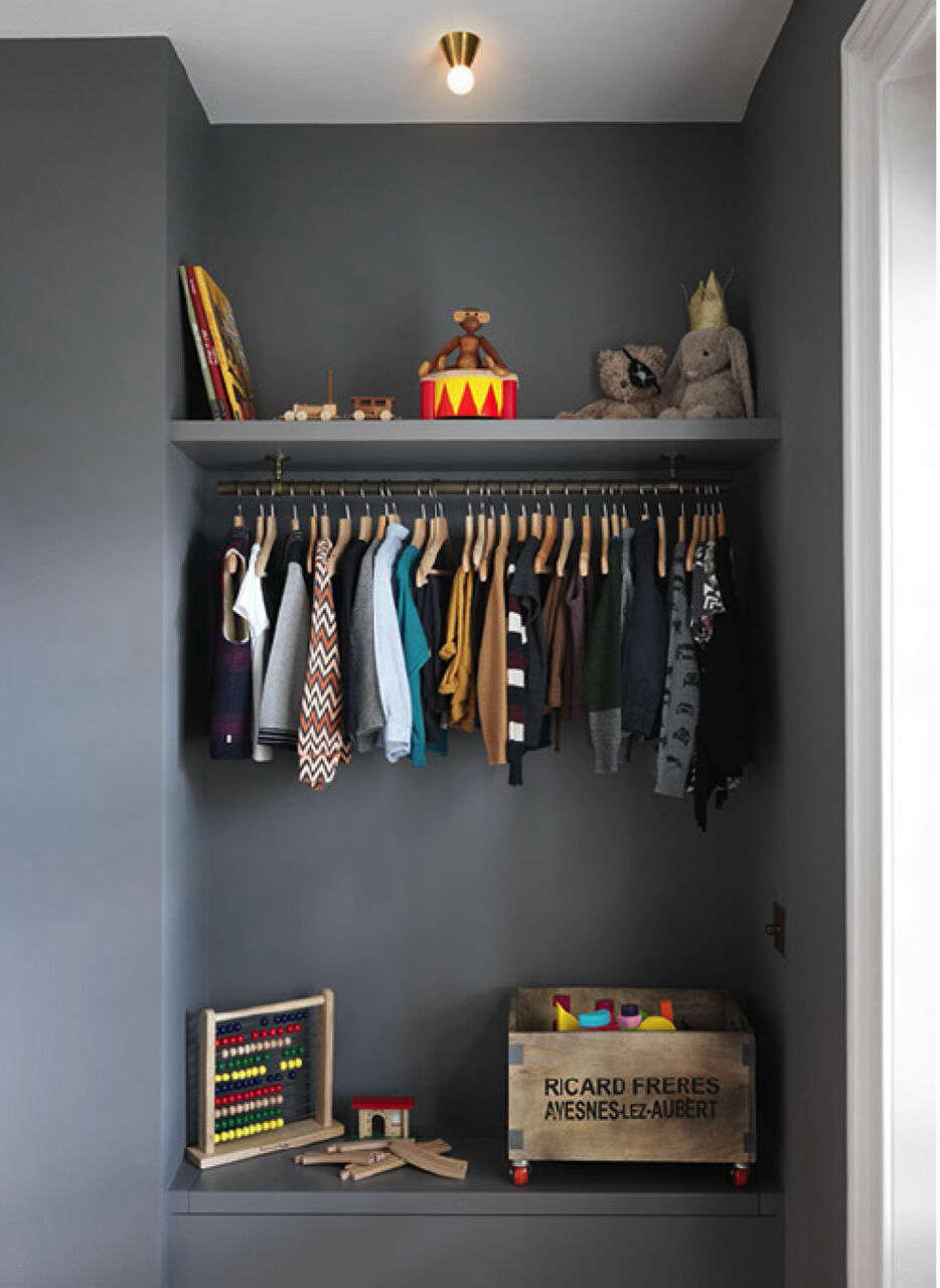 A Notting Hill Townhouse Tailored for Living by Charles Mellersh Child's open closet painted gray a remodeled historic Notting Hill townhouse, interior design by Charles Mellersh   Remodelista