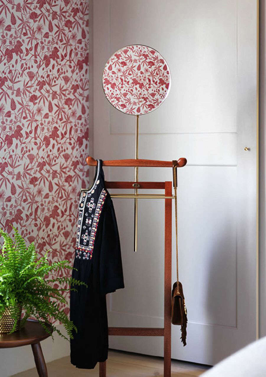 A Notting Hill Townhouse Tailored for Living by Charles Mellersh Marthe Armitage Hop Garden wallpaper and a wood valet in the master bedroom of a remodeled historic Notting Hill townhouse, interior design by Charles Mellersh   Remodelista