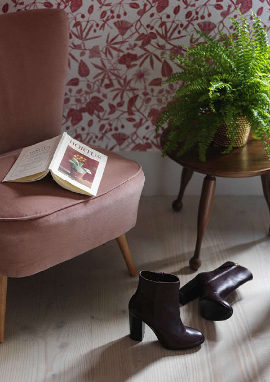 A Notting Hill Townhouse Tailored for Living by Charles Mellersh Pink velvet upholstered chairs in the master bedroom of a remodeled Notting Hill townhouse with interior design by Charles Mellersh   Remodelista