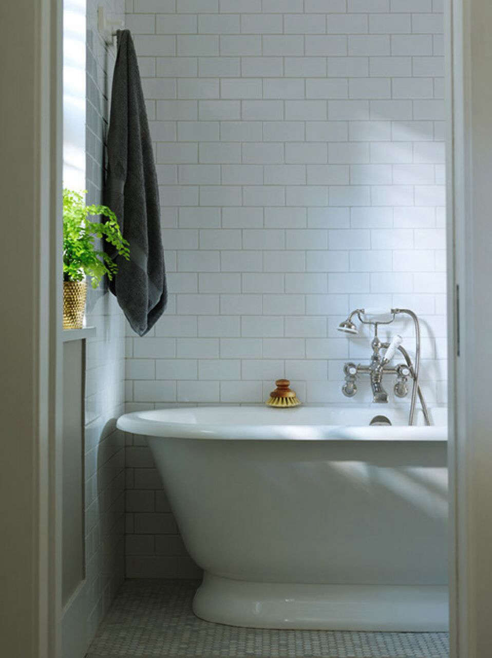 A Notting Hill Townhouse Tailored for Living by Charles Mellersh Victorian style freestanding porcelain bathtub and subway tile in a remodeled historic Notting Hill townhouse, interior design by Charles Mellersh   Remodelista
