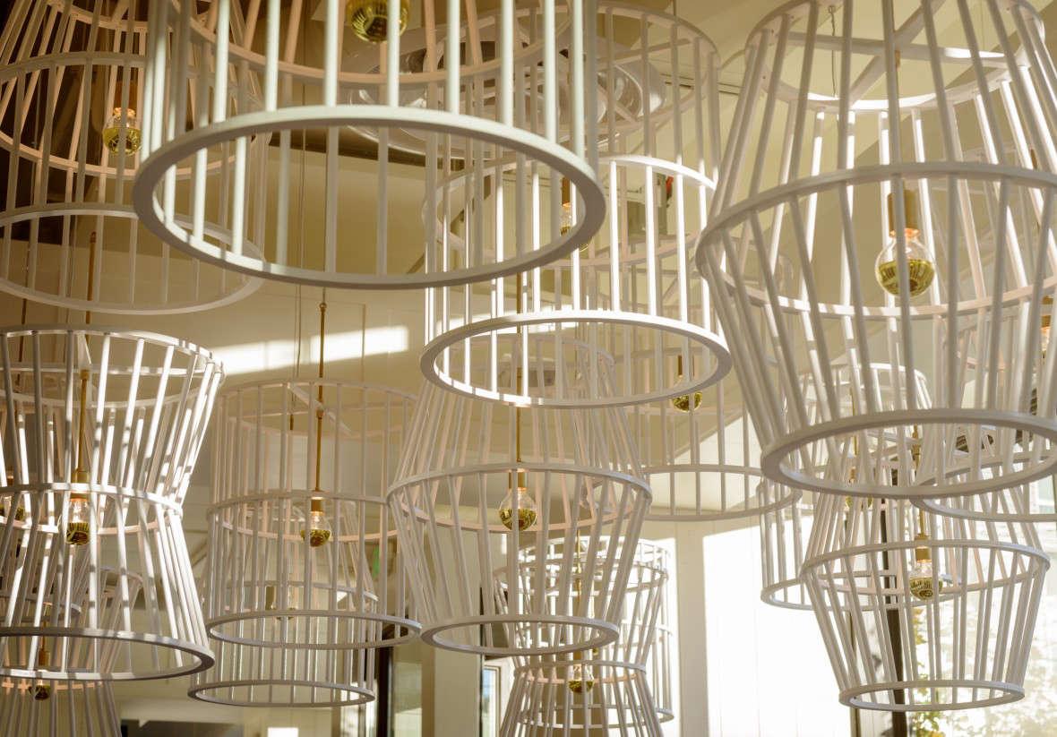 Simple pendant cord lights hangin wooden basket shades.