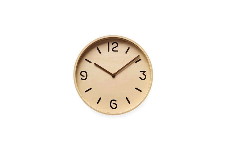 The Bi-Color Plywood Clock from Yuichi Nara has a wood face with die-cut numbers; $95 at the MoMA Store.