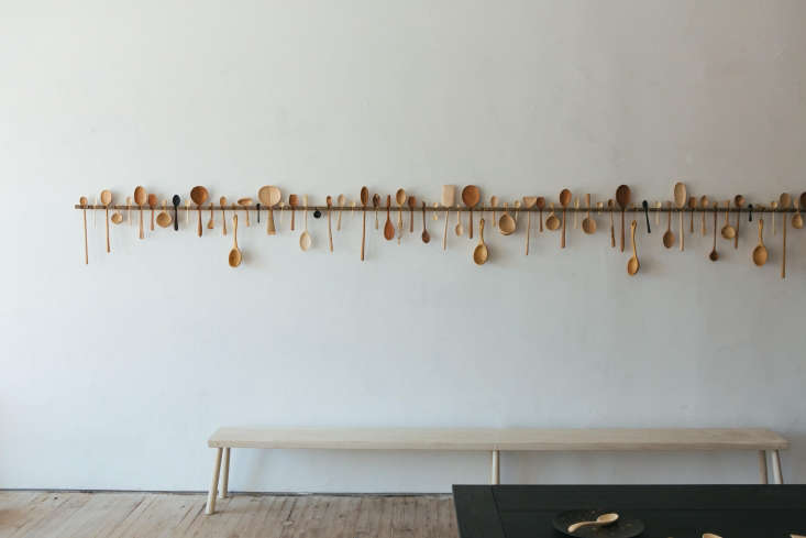 an array of hand turned wooden spoons line the wall at the blackcreek mercantil 11