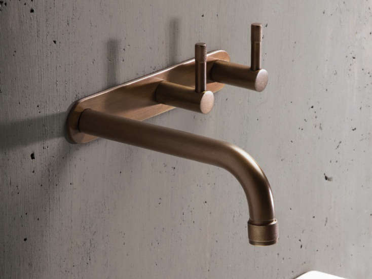 The Wall Set in weathered brass organic finish, meant to take on a patina over time. The Yokato line is made in Australia.