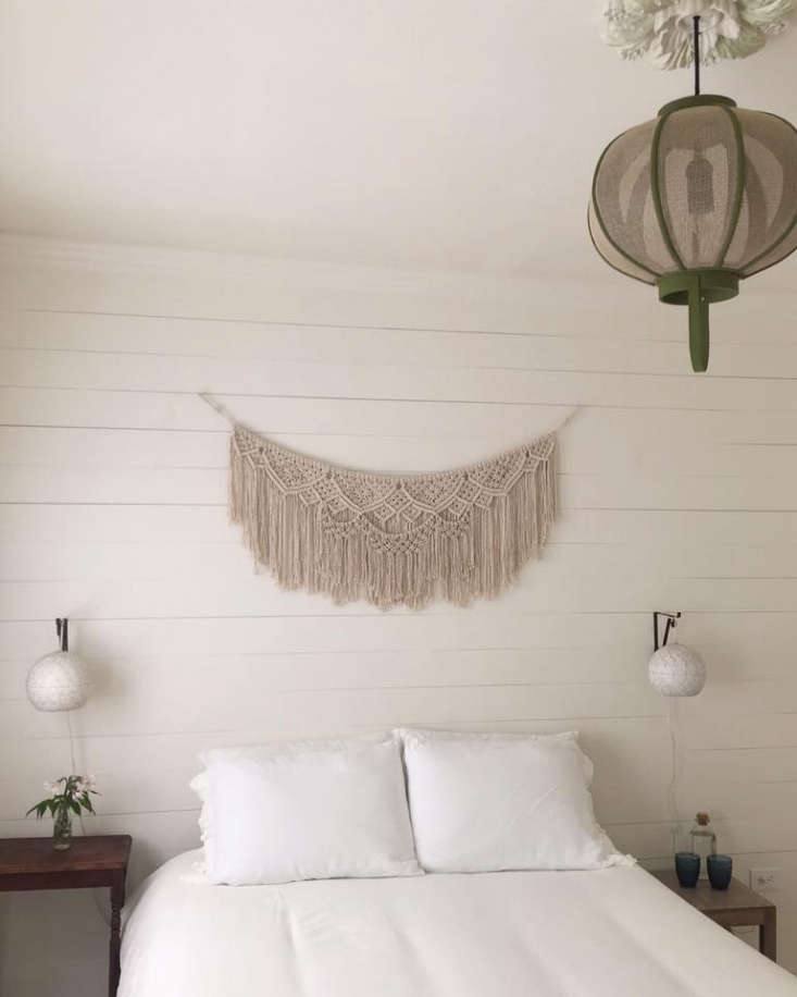 Bohemian Mastermix Foxfire Mountain House in the Catskills A macramé artwork hangs over one of the beds.
