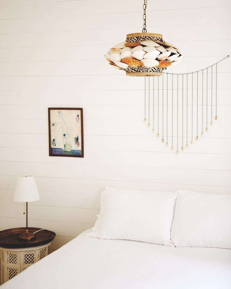 Bohemian Mastermix Foxfire Mountain House in the Catskills In another bedroom, a vintage seashell encrusted lamp adds a note of kitsch.