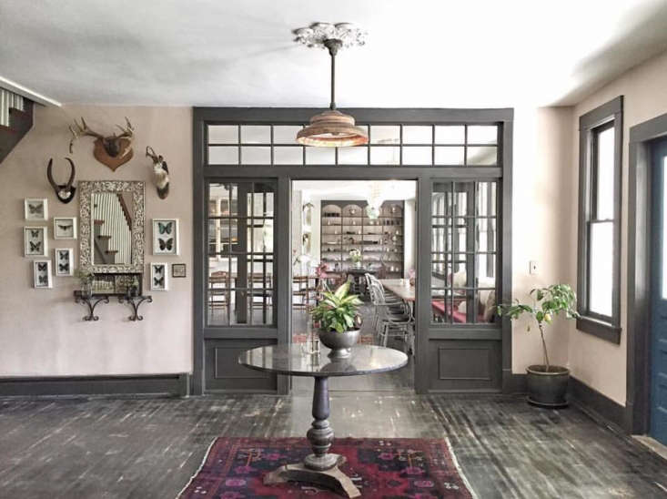 Bohemian Mastermix Foxfire Mountain House in the Catskills The entry hall is anchored by a round table and the walls are hung with vintage finds (framed butterflies included) that the couple has collected over the years.