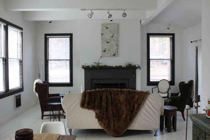 Bohemian Mastermix Foxfire Mountain House in the Catskills The interior of the cottage received a head to toe coat of white paint; window frames are painted black for contrast.
