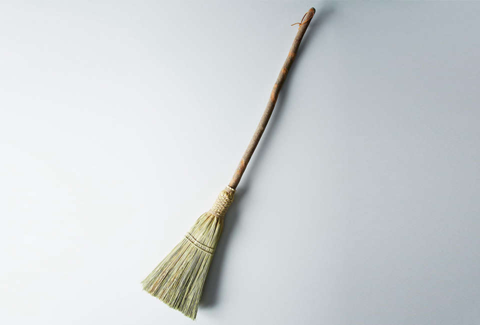 the traditional broom is attached to its sassafras handle by a decorative weave 24
