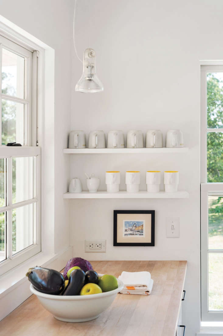 mugs at the ready for renters; for more of this kitchen, see kitchen of the wee 10