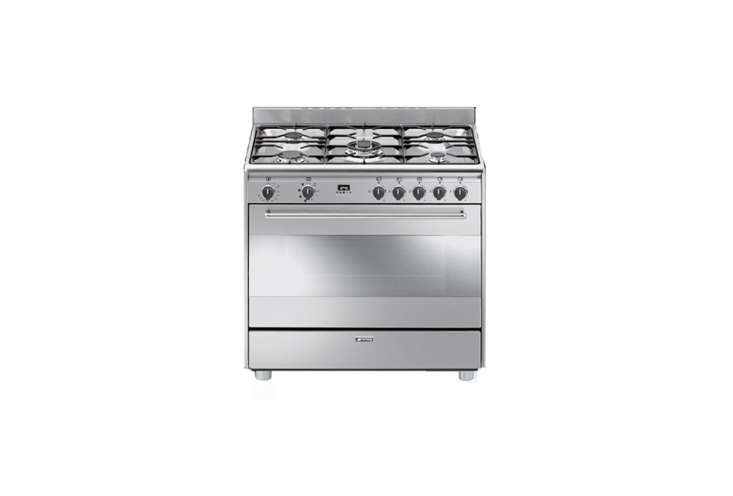TheSmeg 36-Inch Freestanding Dual Fuel Range with five sealed burners and a 4.4 cubic foot convection oven is $loading=