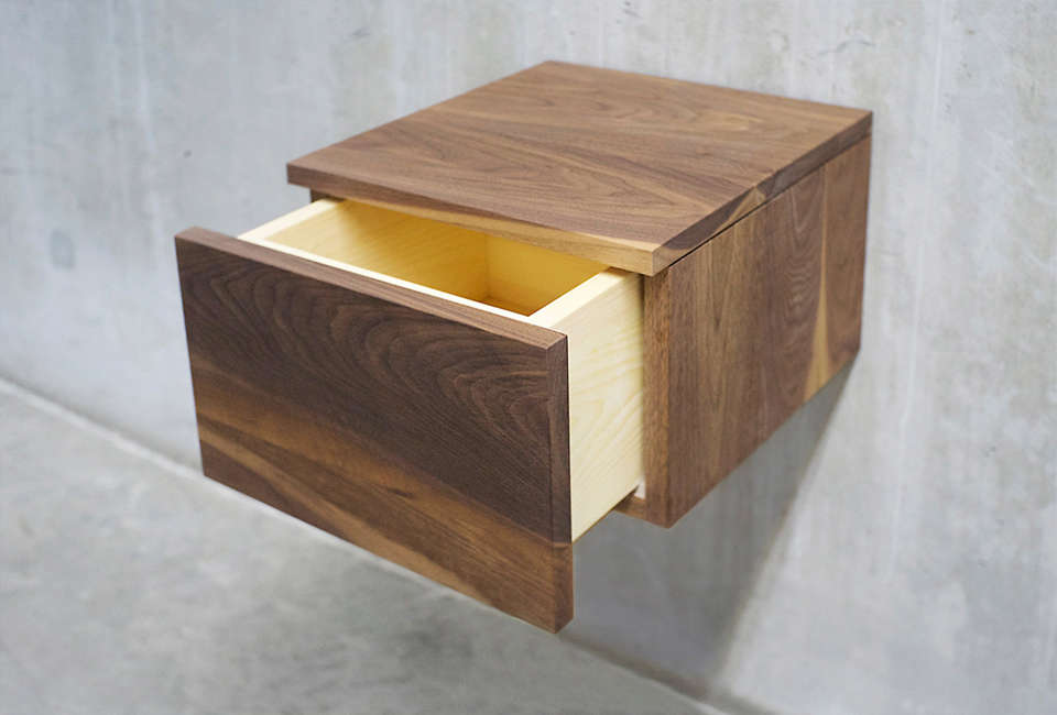 from solid wood limited in toronto, the black walnut floating nightstand has a  12