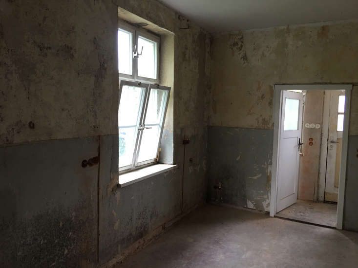 the space came with atmospheric two toned walls, replaced windows, and windowed 19