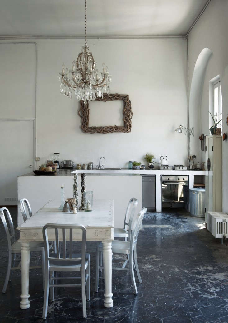 A Romantic/Industrial Milan Loft for a Bohemian Design Duo, glam chandelier included.