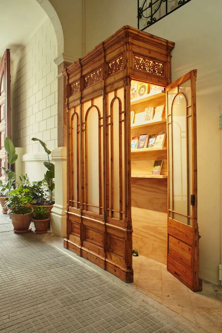 tucked behind carved wooden doorsis casa bonay&#8\2\17;s own library, cur 20