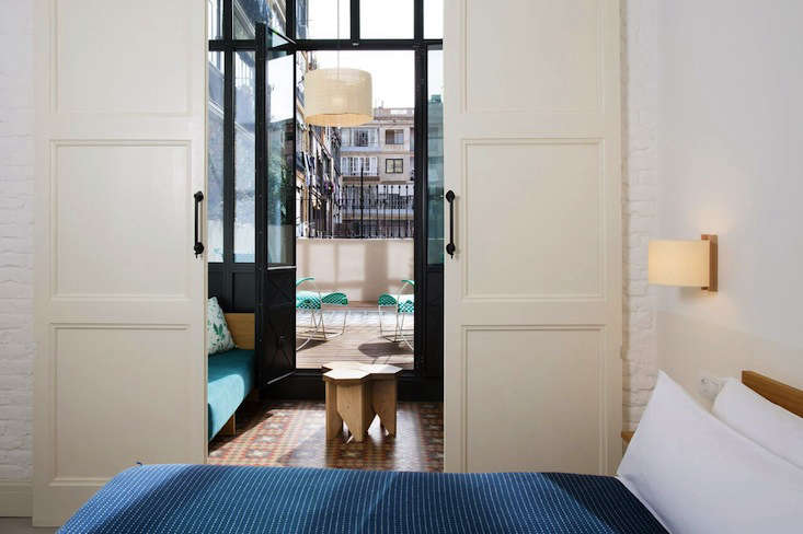 a guest room with original mosaic floor tiles, sliding doors, and a glassed in  15