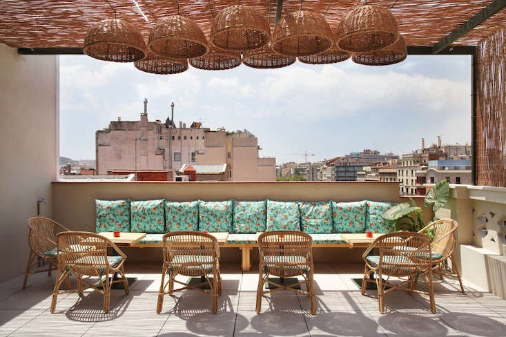 a rooftop terrace overlooks the city. 22