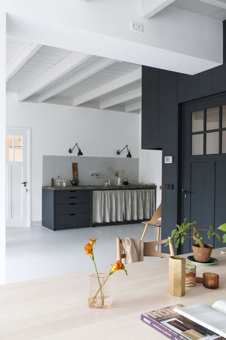 A curtained kitchen with a small tiled backsplash from Kitchen of the Week: The Curtained Kitchen, Dutch Modern Edition.