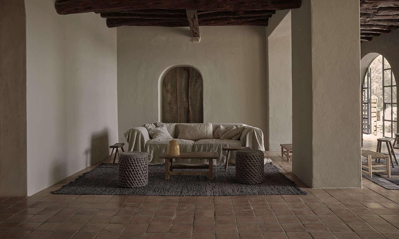 Linen-cloaked sofa at La Granja Ibiza, a Design Hotels retreat on a 16th century finca | Remodelista