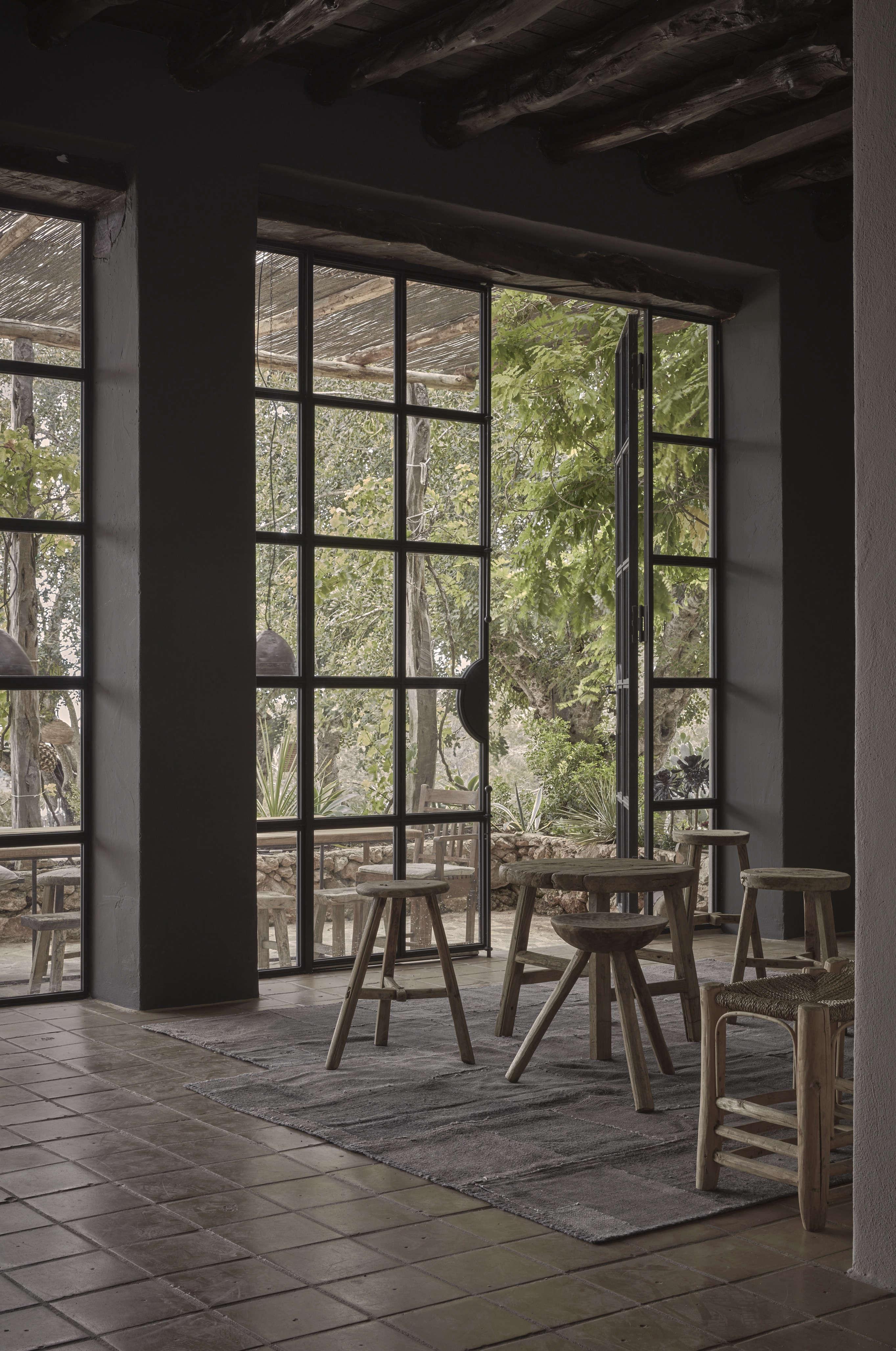 Steel-framed windows at La Granja Ibiza, a Design Hotels retreat on a 16th century finca | Remodelista