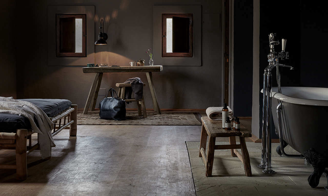 En suite rustic-luxe bathroom at La Granja Ibiza, a Design Hotels retreat on a 16th century finca | Remodelista