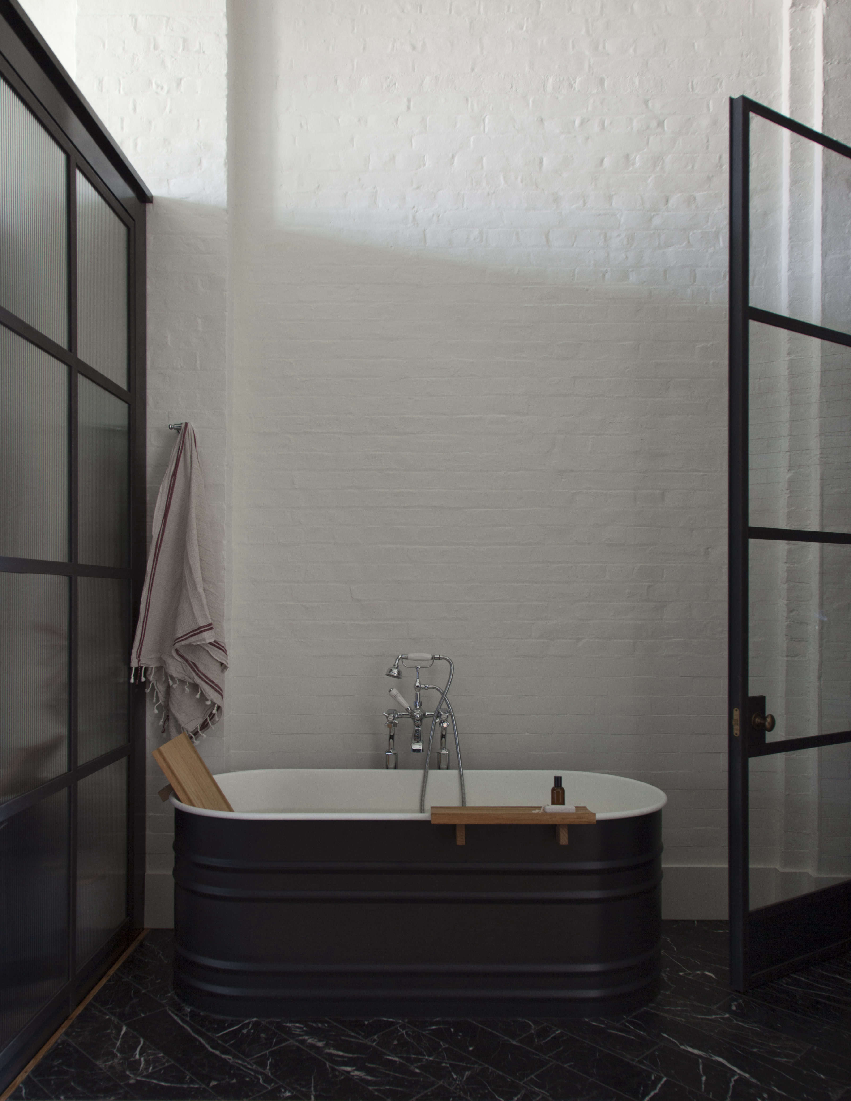 an industrial chic bathroom with steel framed glass doors by plain english | re 12
