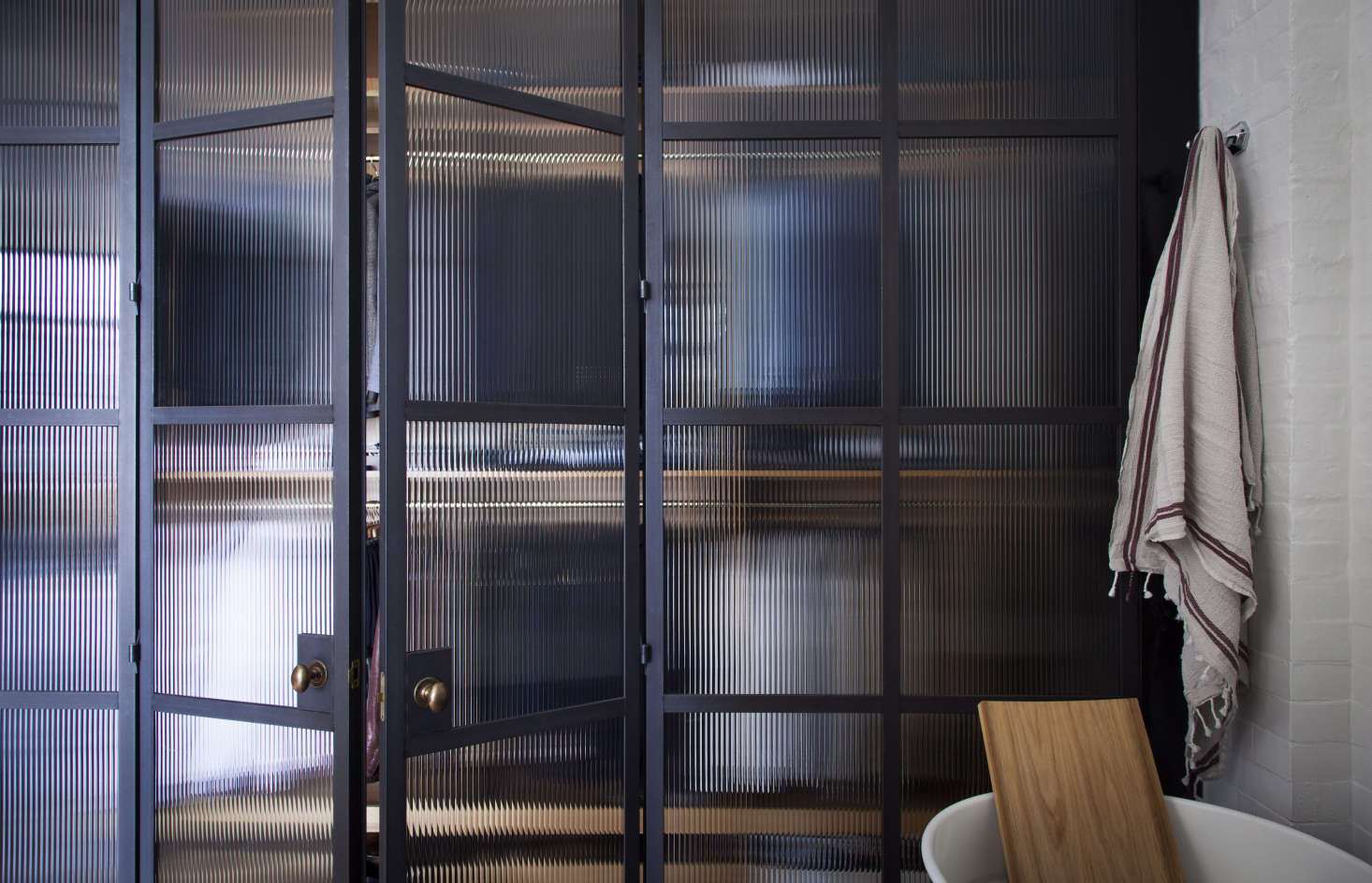 An industrial-chic bathroom with steel-framed glass doors by Plain English | Remodelista