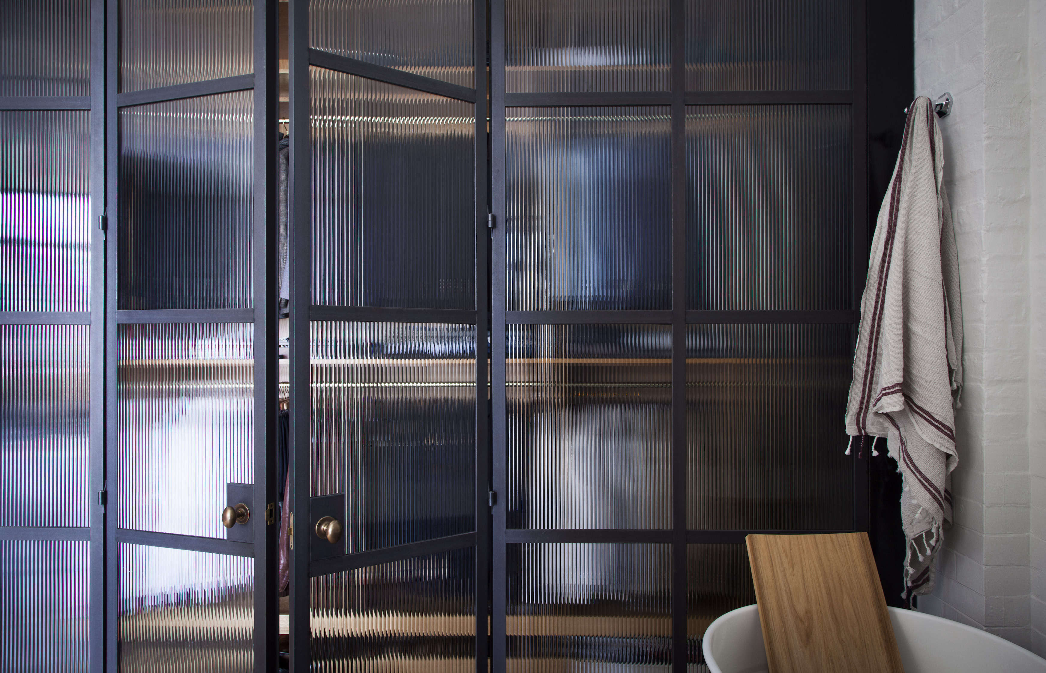 an industrial chic bathroom with steel framed glass doors by plain english | re 13