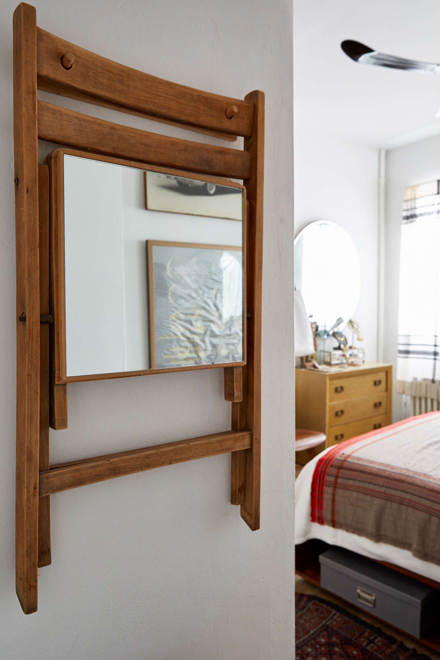 Small-space solutions: a mirror on the under seat of a hanging folding chair