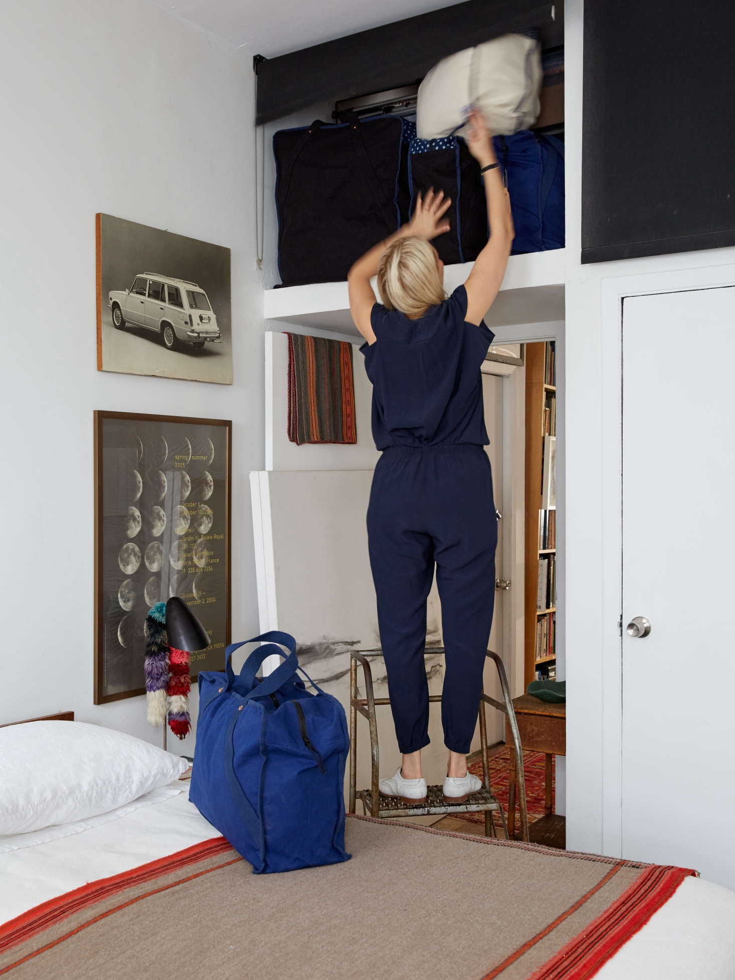 Small-space solutions: Over-the-closet loft storage in a small bedroom