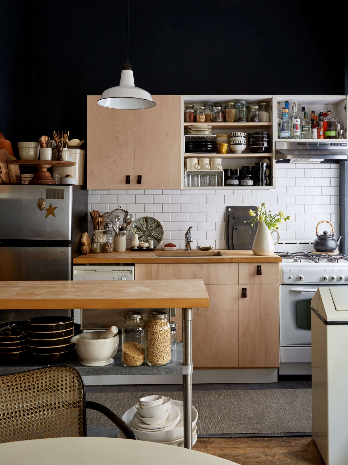 The couple in this New York apartment took their double cabinet doors off of one unit. Fortunately, the cabinet boxes are frameless—no framework or center panel divides the cabinet space. SeeSmall-Space Solutions:  Affordable Tips from a NYC Creative Couple for a full look.