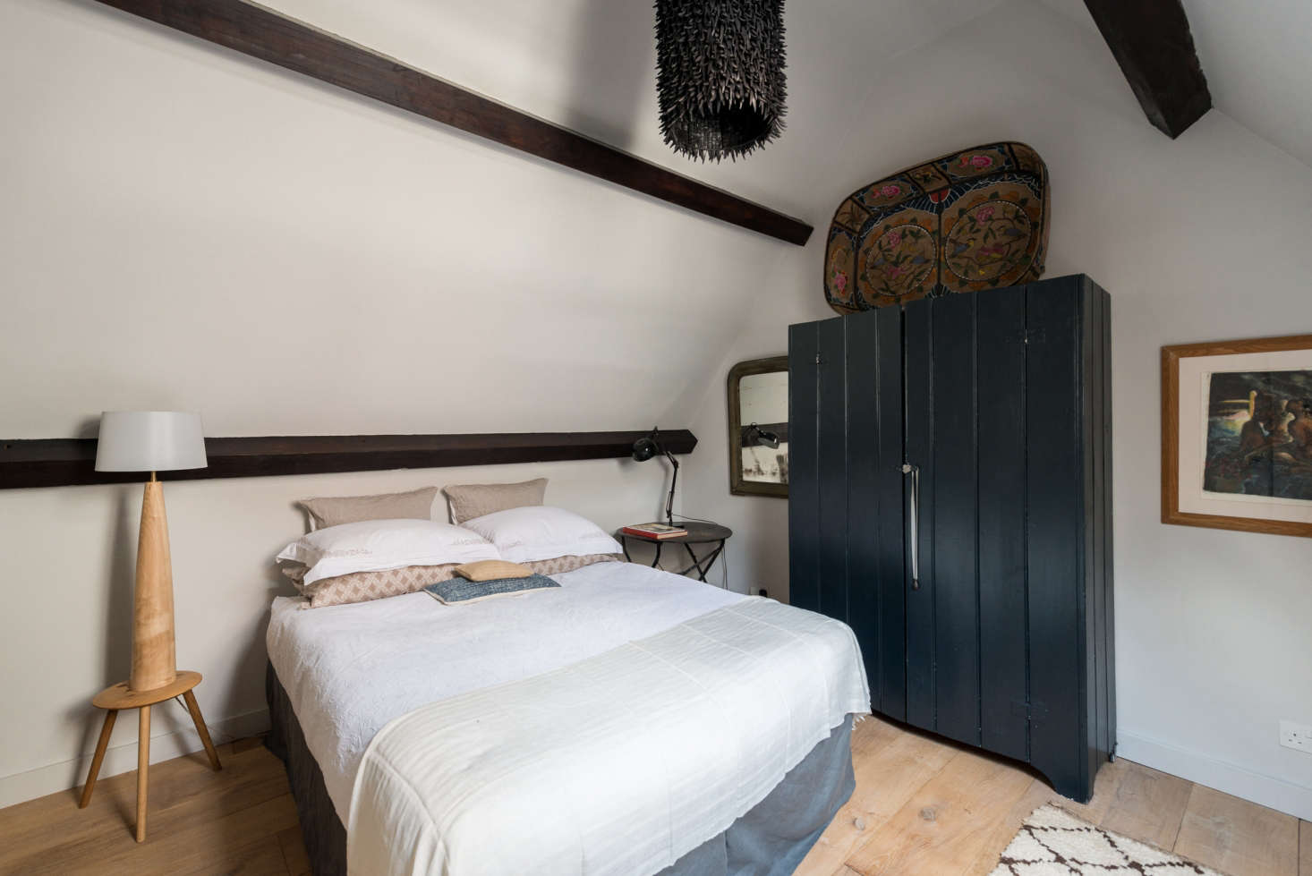 Mix-and-match bedside table lamps do the trick. SeeSteal This Look: An Artful Attic Bedroom in London for more.