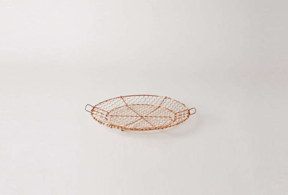 The Handwoven Netted Copper Tray is traditionally used in Japanese cooking for frying food. It&#8